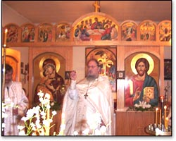 Father Rostislav serves on the day of Pascha.